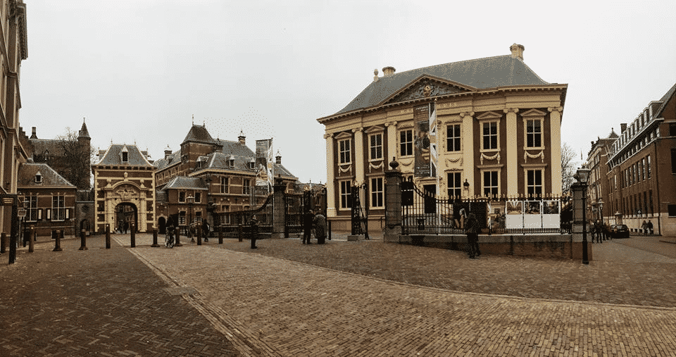 The Hague is certainly worth a visit, here you'll find the Dutch Government.