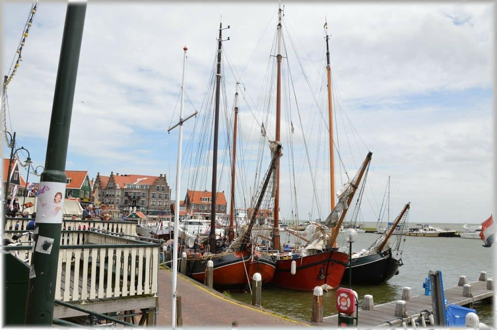 Visit Volendam, a typical Dutch city. It's easily done as a day trip from Amsterdam. Here you'll be able to take photos in traditional Dutch clothing.