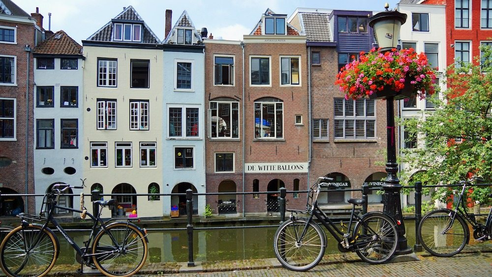 Amsterdam isn't the only Dutch city with canals. Actually a lot of Dutch cities have traditional herenhuizen and canals. Such as Utrecht, but in Utrecht it's a bit smaller.