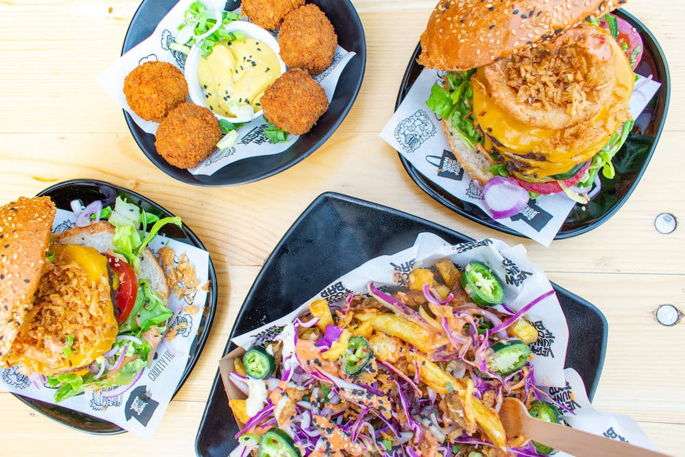 "Vegan junk foor bar in Amsterdam serves all mouth-watering plant-based burgers to loaded fries, piled high with cheese, shawarma and fried onions, nothing about this joint says ""health food"""